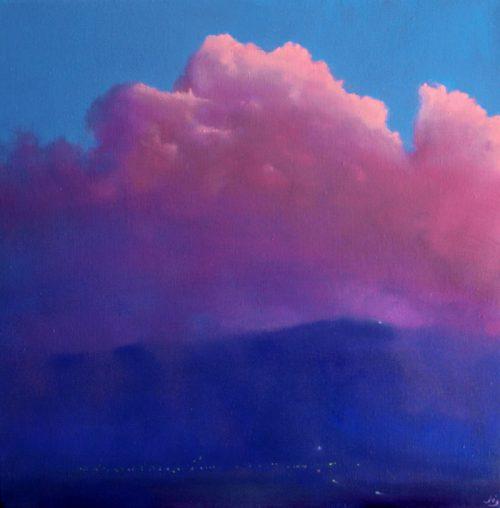 A large pink cumulus cloud