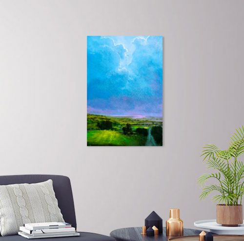 Looking Up by John O'Grady in a living room setting | Acrylic landscape with big clouds hovering over green lush Irish fields