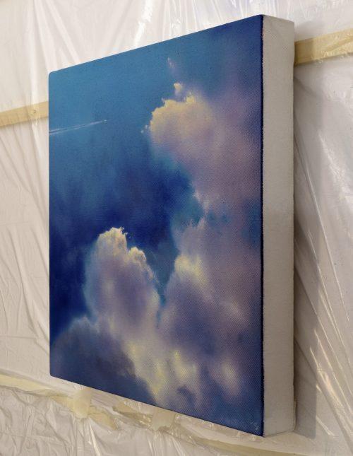 Icarus I by John O'Grady side view | Billowing clouds in a dark blue sky