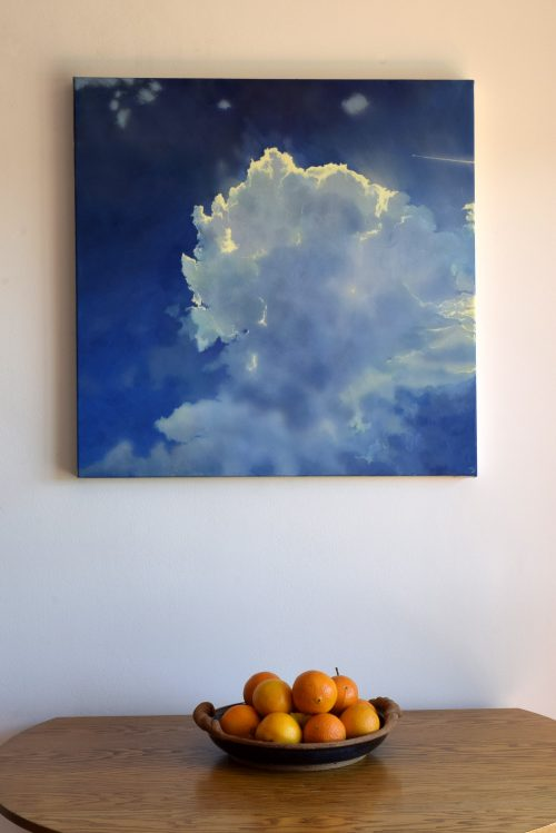 Icarus IV by John O'Grady | A skyscape displayed on a wall above a bowl of fruits