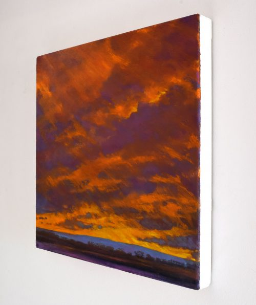 Sideview of Winter Sunset Painting with gold and purple sky called 'On Looking West' by John O'Grady