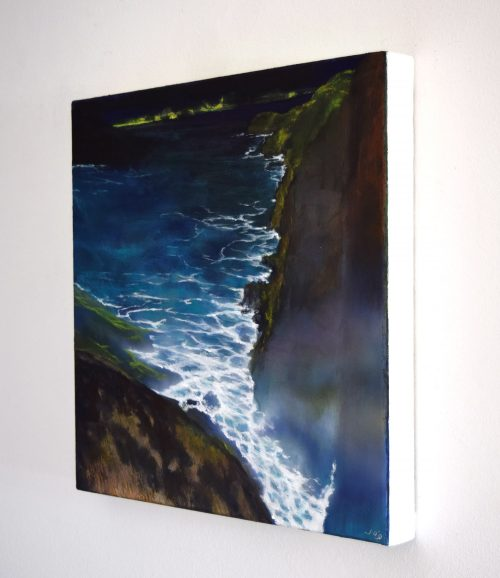 Sideview of 'The Edge of the Deep Green Sea III' painting by John O'Grady A seascape with waves crashing against a cliff face